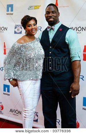 NEW YORK-MAY 31: Actress Vivica A. Fox and York Giants player Justin Tuck attend the 4th annual Tuck�s Celebrity Billiards Tournament at Slate on May 31, 2012 in New York City.