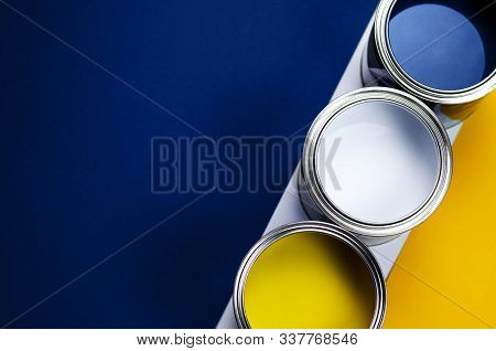 Cans Of Paint On A Background Of Yellow And Classic Blue. Color Of The Year 2020. Main Color Trend C