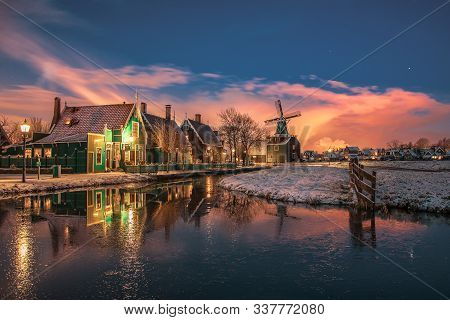 Zaanstad, Netherlands, January 30, 2015:  Small Mill And Typical Zaanse Houses On The Zaans Schans I