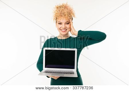Cute Young Woman Holds Notebook With Mockup With Screen Forward On A White Background.