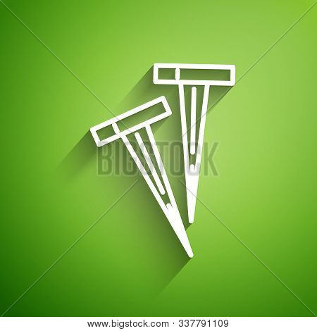 White Line Pegs For Tents Icon Isolated On Green Background. Extreme Sport. Sport Equipment. Vector