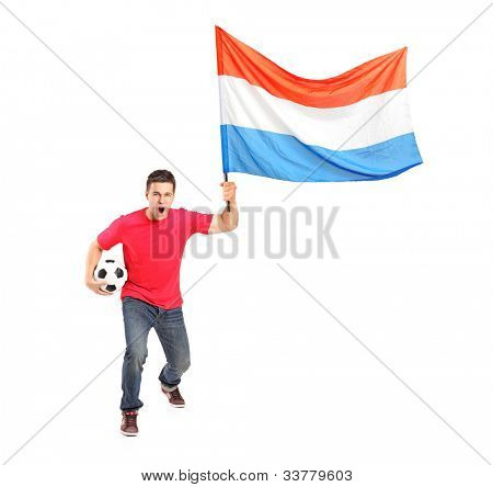 Full length portrait of a male euphoric fan holding a football and dutch flag isolated on white background