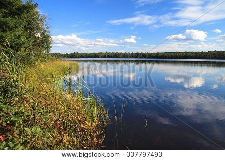 Wilderness Forest Lake. Clouds Reflected On The Surface Of A Pristine Northern Michigan Wilderness L