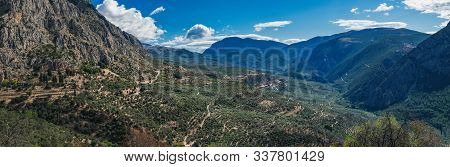 Scenic Landscape With Picturesque Mountains, Cloudy Sky And Coniferous Forest On The Hillside Near D
