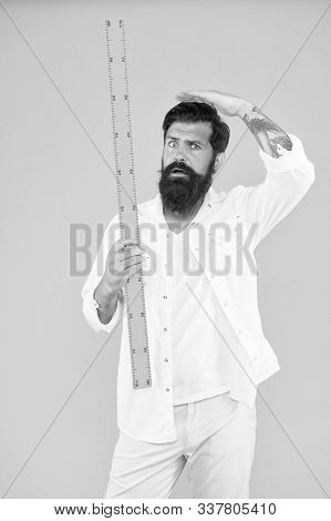 Small Little Big Large. Does Size Really Matter. One Meter. Man Bearded Hipster Holding Ruler. Measu
