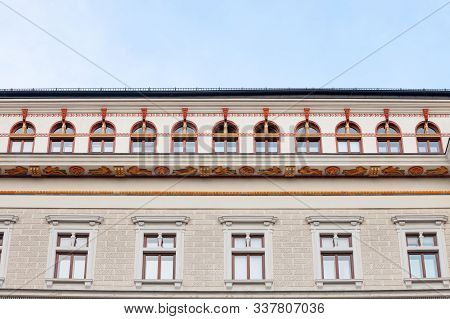 Typical Austro-hungarian Facades With Old Windows Of A Cultural Museum And Palace In A Street Of Inn