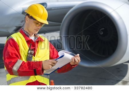 Airline safety engineer going through a pre-flight checklist
