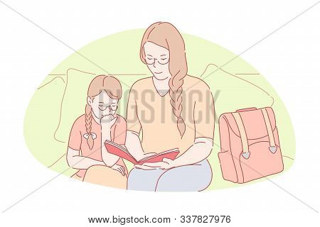 Family Bonding, Home Education, Happy Motherhood Concept. Young Mom Helping Little Daughter With Hom