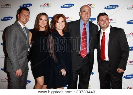 NEW YORK-JUNE 4: Caroline Manzo (center) and family attend Samsung's Annual Hope for Children gala at the American Museum of Natural History on June 4, 2012 in New York City.