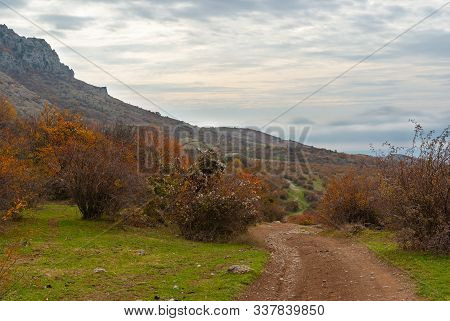 Fall Landscape With An Earth Road On Mountain Pasture Demerdzhi, Crimean Peninsula