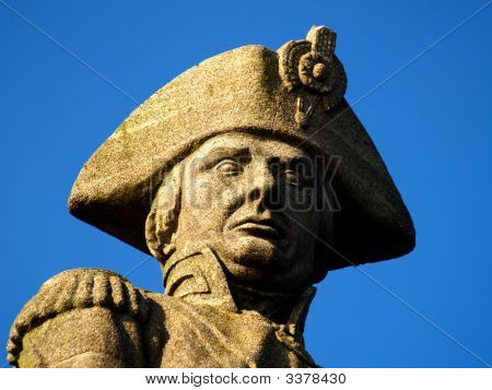 a close up of a statue of lord nelson on anglesey in north wales. poster