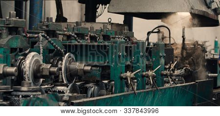 Industrial Steel Roll Coil For Metal Profile Forming Machine In Metalwork Factory Workshop. Sprocket
