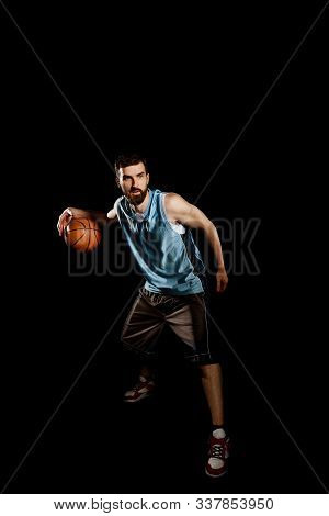 Man Dribbling A Ball. Full Body Portrait Of Handsome Basketball Player