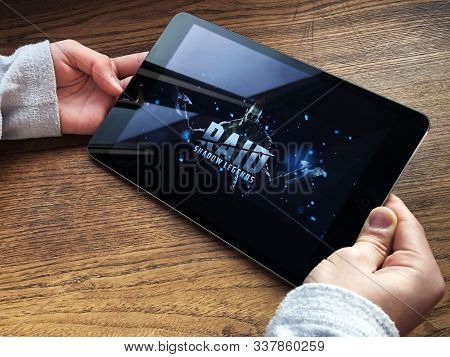 December 2019 Parma, Italy: Raid Shadow Legends Game Application On Tablet Screen. Boy Holding Table