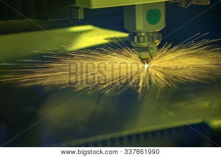 The Fiber Laser Cutting Machine Control By Cnc Program System. The Hi-technology Sheet Metal Manufac