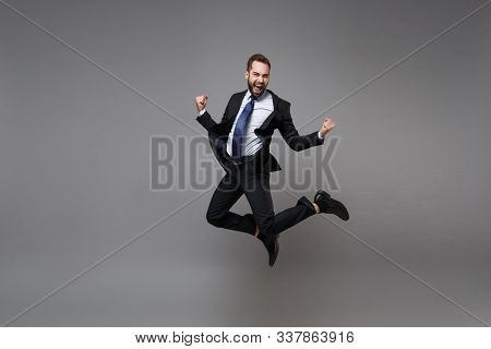 Joyful Young Business Man In Classic Black Suit Shirt Tie Posing Isolated On Grey Background. Achiev
