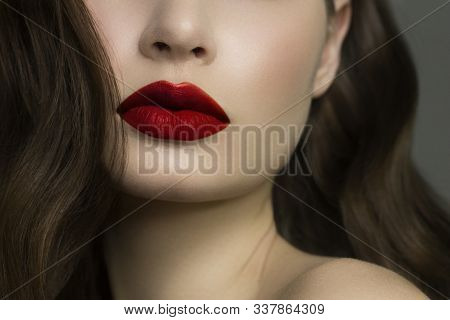 Close-up Of Woman's Lips With Fashion Natural Red Lipstick Makeup. Macro Sexy Pale Lipgloss Make-up