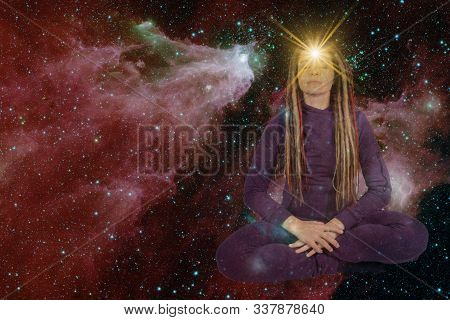 Girl With Soulful Look Against Background Of Starry Sky. On Forehead Of Girl Glowing Star Symbol Of