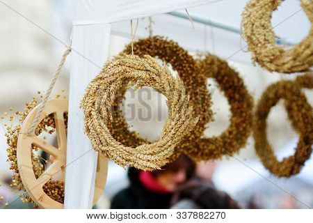 Traditional Lithuanian Straw Wreaths Sold On Easter Market In Vilnius, Lithuania