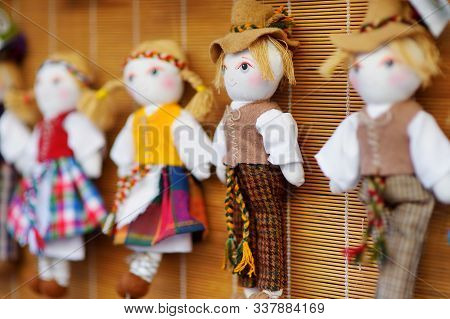 Cute Handmade Ragdoll Dolls In Lithuanian National Costumes Sold On Easter Market In Vilnius, Lithua