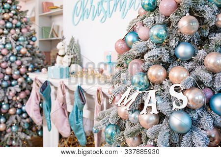 Room With Firtree Decorated To Christmas Holidays, Fireplace, Christmas Stockings. Christmas Tree Wi