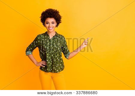 Photo Of Pretty Dark Skin Curly Lady Sales Manager Indicating Finger Empty Space Advising Buyer Nove
