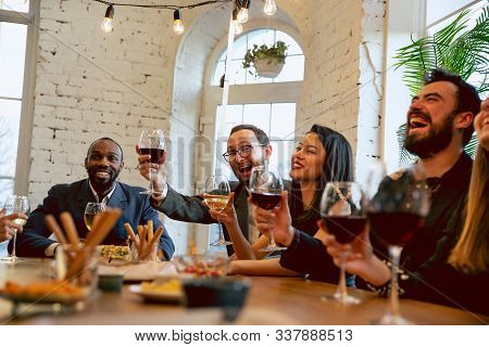 Happy Co-workers Celebrating While Company Party, Corporate Event. Young Caucasian People In Busines