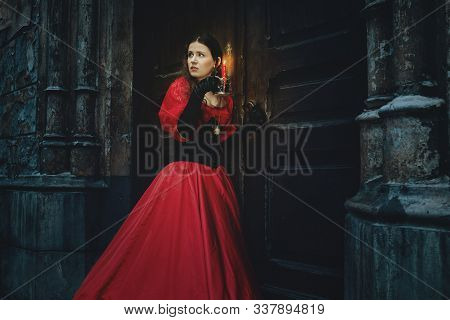 Mysterious Woman In A Red Victorian Dress By The Old Door