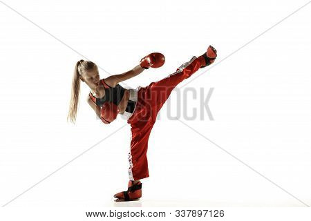 Young Female Kickboxing Fighter Training Isolated On White Background. Caucasian Blonde Girl In Red