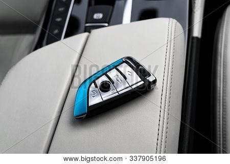 Closeup Inside Vehicle Of Wireless Key Ignition On White Perforated Leather Seat. Wireless Start Eng
