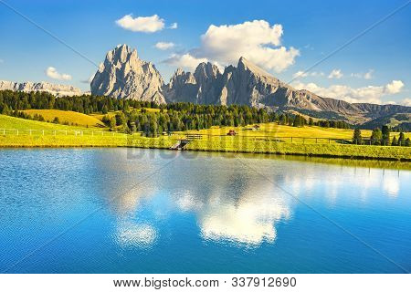 Lake And Mountains At Sunset, Alpe Di Siusi Or Seiser Alm, Dolomites Alps Sassolungo And Sassopiato,