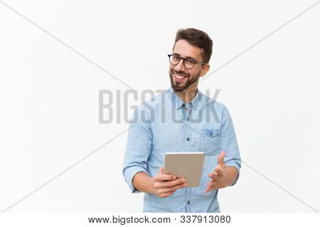 Happy Joyful Guy With Tablet Getting Good News, Looking At Camera, Smiling, Gesturing. Handsome Youn