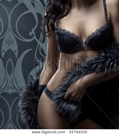 Fashion shoot of beautiful woman in luxury lingerie