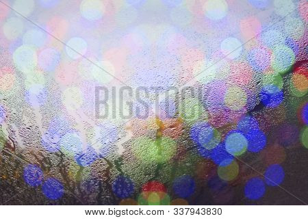 An Abstract View Of Vertical Streaks Of Moisture Collected On A Steamy Glass Window With Colorful Tr