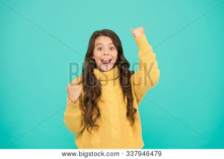 Adorable Small Girl In Cozy Fashion Style. Knitting For Kids. Little Girl On Blue Background. Pure B