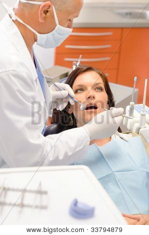 Scared patient at dentist office have teeth checkup stomatology
