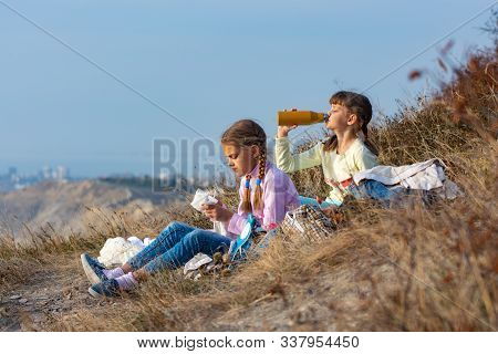 Girls On A Rest On A Halt And Drink Water