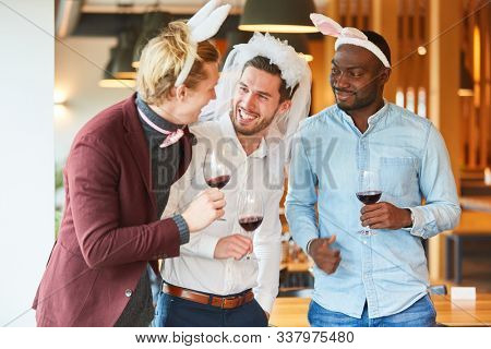 Friends in funny disguise celebrate a bachelor party in a bar