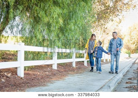 Mixed Race Family Taking A Walk Outdoors.