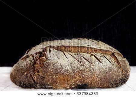 Loaf (or miche) of French sourdough, called as well as Pain de campagne, on display on a black and white background. Pain de Campagne is a typical French huge loaf of bread abiding by traditional codes. poster