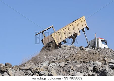 Truck Unloading Dump Load Debris On Construction Area