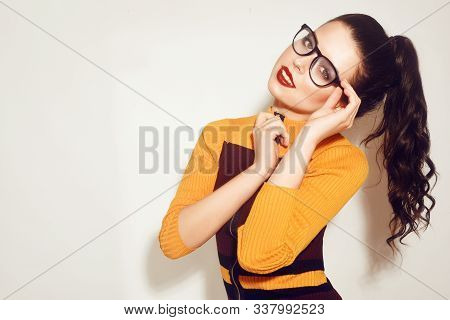 Beauty Fashion Brunette Model Girl Wearing Stylish Glasses. Girl Sends A Kiss To The Camera, Trendy