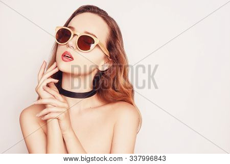Stylish Beauty Model Girl Wearing Dark Wooden Sunglasses And Dress. Fashion Beautiful Woman With Lon