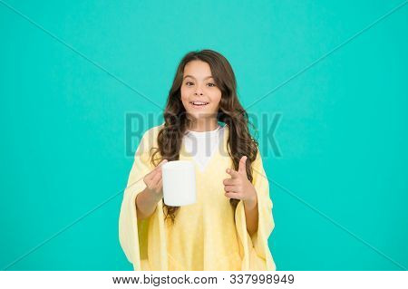 Kid Wearing Soft Poncho Drinking Tea. Little Girl With Long Hair. Feeling Comfy. Adorable Child On T