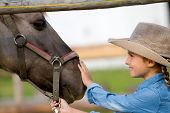 Ranch - Lovely girl with horse on the ranch poster