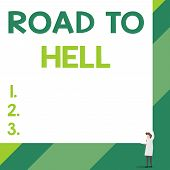 Handwriting text Road To Hell. Concept meaning Extremely dangerous passageway Dark Ri Unsafe travel Front view young woman holding two hands right corner big blank rectangle. poster