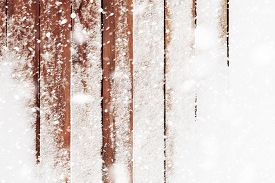 The Brown Wood Texture With Snow Flakes Over It. Winter Christmas Background