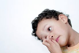 Boy Picking His Nose And Having Fun With White Background Stock Photo