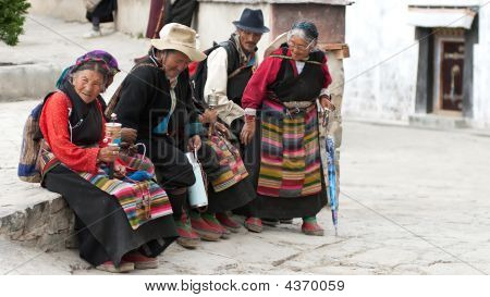 Lhasa, Tibet China - July 6: Group Of Local Tibetans Are Seating And Holding Nepalese Prayer Wheels