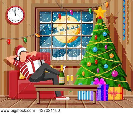 Cozy Interior Of Living Room With Window, Man On Armchair, Table, Christmas Tree. Happy New Year Dec